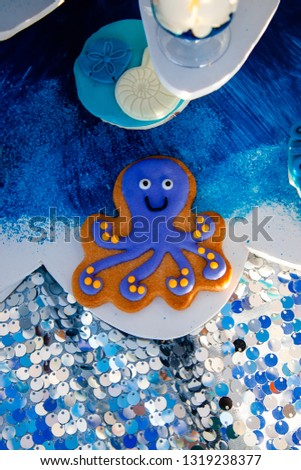Homemade homemade gingerbread cookies in the form of crab, turtile, octopus and a starfish on the wooden table. Space for text and selective focus. #1319238377