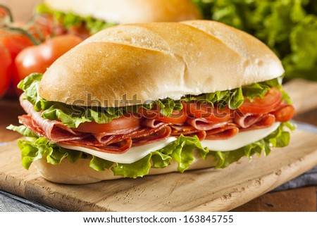 Homemade Italian Sub Sandwich with Salami, Tomato, and Lettuce