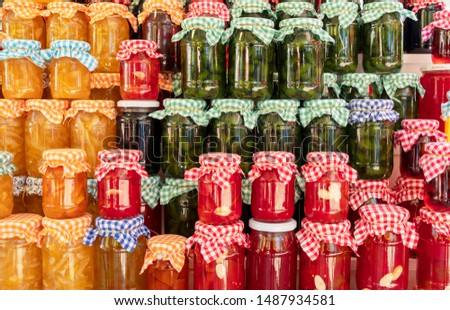 Homemade jam for sale at a farmer's market. Colorful jam jars.  ストックフォト ©
