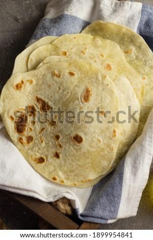Homemade Kulit Kebab or Tortilla wrap on blue white napkin on wooden rustic tray.  Foto stock ©