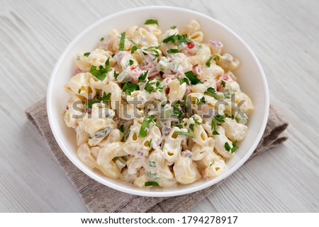 Homemade Macaroni Salad in a white bowl on a white wooden background, side view. Close-up. Stock fotó ©