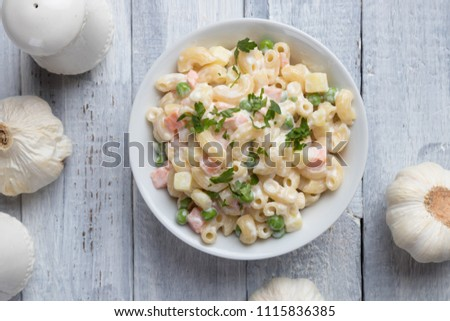Homemade macaroni salad with elbow pasta, vegetables and mayonnaise dressing