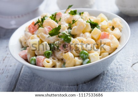 Homemade macaroni salad with elbow pasta, vegetables and mayonnaise dressing Stock fotó ©