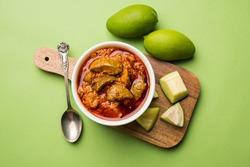 Homemade Mango Pickle or aam ka achar or Kairi Loncha in a white bowl, selective focus
