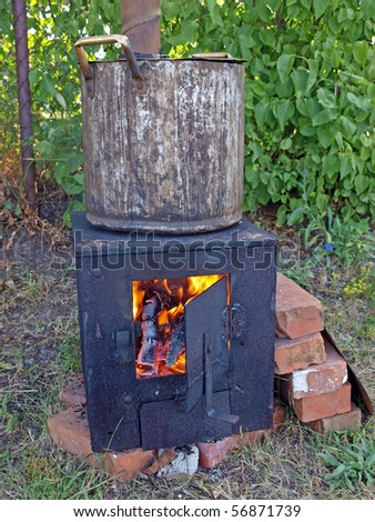 Homemade metal outdoor stove for summer time