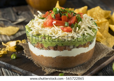 Homemade Mexican 7 Layer Dip with Beans, Sour Cream and Guacamole #565722865
