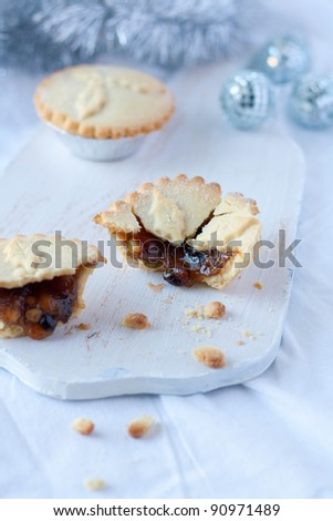 Homemade minced pies on a chopping board