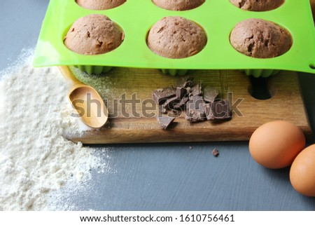 Homemade muffins with chocolate. Ingredients for baking. Copy space. Baking ingredients for chocolate brownies.