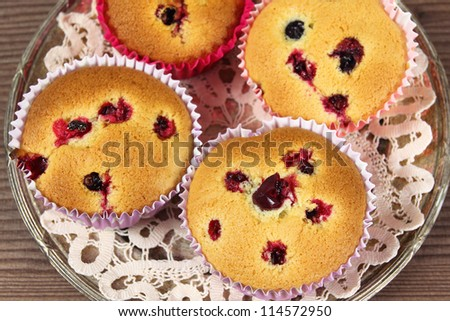 Homemade muffins with cranberries and cowberry on a silver platter.