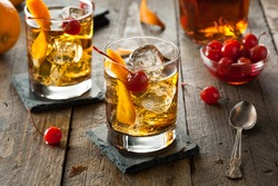 Homemade Old Fashioned Cocktail with Cherries and Orange Peel