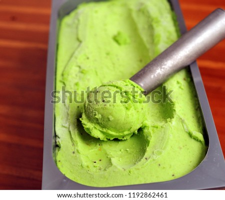 Homemade Organic fruit ice cream scoop, scooped out of a container