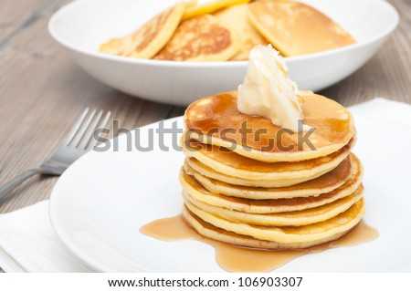 Homemade Pancakes With Butter and Warm Maple Syrup