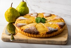 Homemade pear tart on a marble background