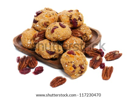 Homemade pecan and cranberry cookies on white background