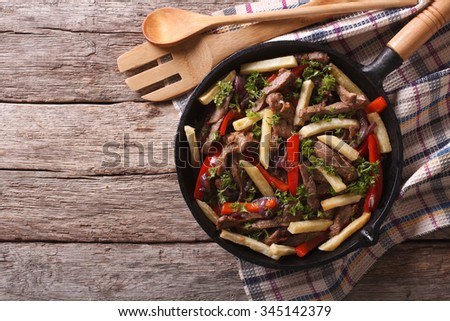 Shutterstock Homemade Peruvian Food: Lomo saltado in a frying pan. horizontal view from above