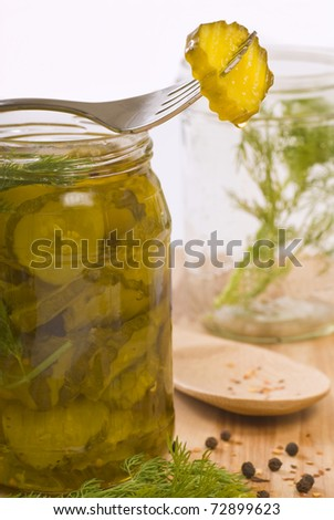 Homemade pickles being preserved with dill and peppercorns #72899623