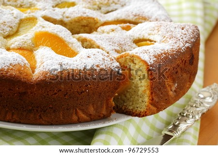 homemade ??pie with peaches, sprinkled with  powdered sugar