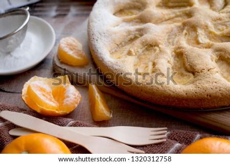 homemade pie with tangerines
