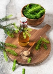 Homemade pine cough syrup made from green young fir tops and nature sugar. Alternative medicine concept.