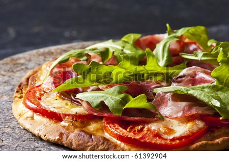 Homemade pizza served on a stone serving dish