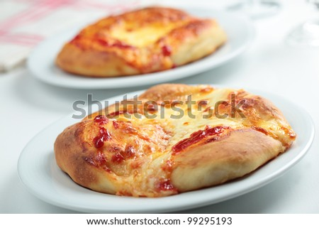 Homemade pizzas with mozzarella and tomato sauce