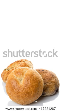 Homemade plain bagel, cheese bagel and blueberry bagel over white background #417221287