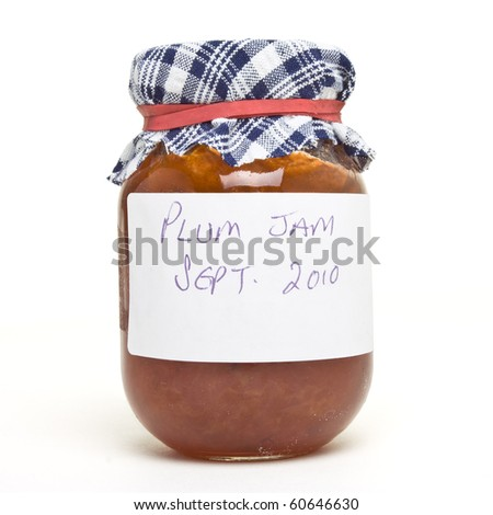 Homemade plum jam from low perspective isolated on white.