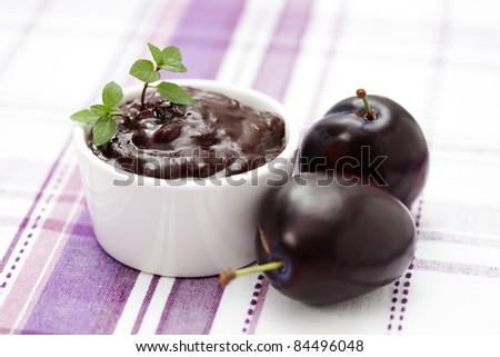 homemade plum jam with fresh plums - goods in jar