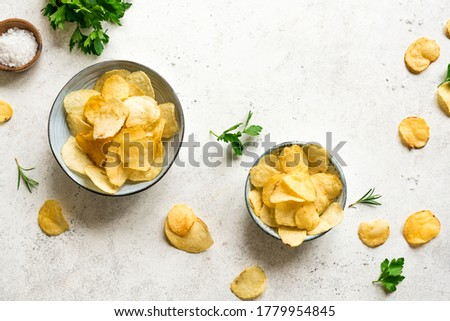 Homemade  potato chips in bowls.  Oven baked crispy potato chips on white background, top view, copy space. Stock fotó ©