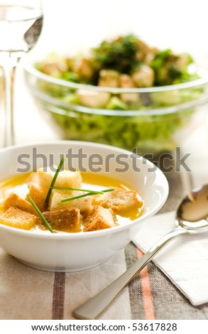 Homemade potato cream soup with green salad