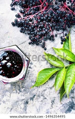 Homemade preserves of fresh elderberry in glass jar