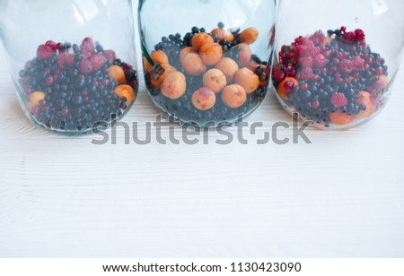 Homemade preserves, prepare compote of berries. Fresh berries in glass bowl with copy space.  #1130423090