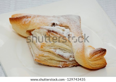 Homemade puff pastry on white background