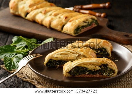 Homemade puff pastry pie with spinach, ham and cheese. #573427723