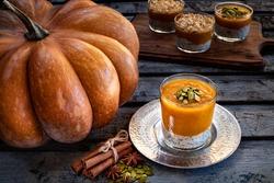 Homemade pumpkin dessert in the glass. Autumn dessert, pumpkin mousse in the glasses