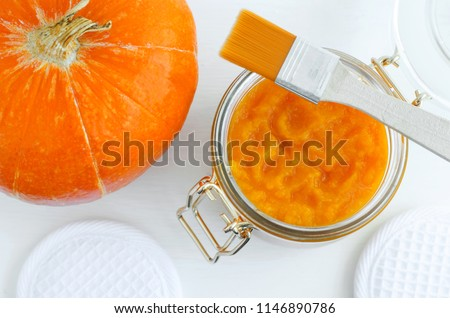 Homemade pumpkin face mask in a glass jar. DIY cosmetics and spa. Top view, Copy space.  - Shutterstock ID 1146890786
