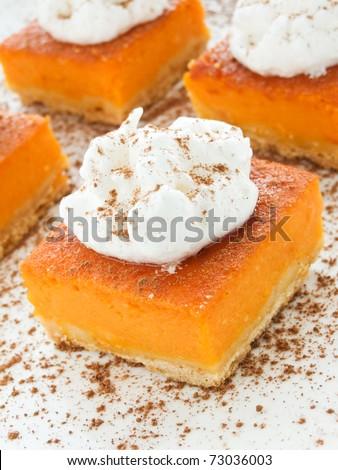 Homemade pumpkin pie with whipped cream. Shallow dof. #73036003