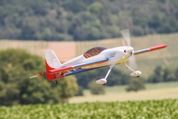 Homemade radio control toy aircraft flying in summer in switzerland