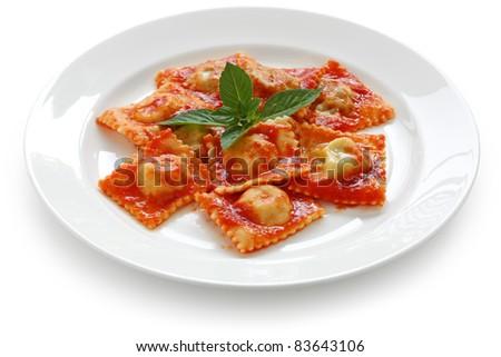 homemade ravioli pasta with tomato sauce , italian food - stock photo