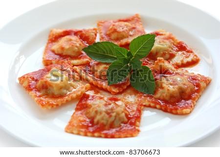 homemade ravioli pasta with tomato sauce , italian food