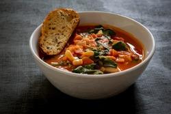 Homemade Ribollita, tuscan bean soup with seed & grains sourdough