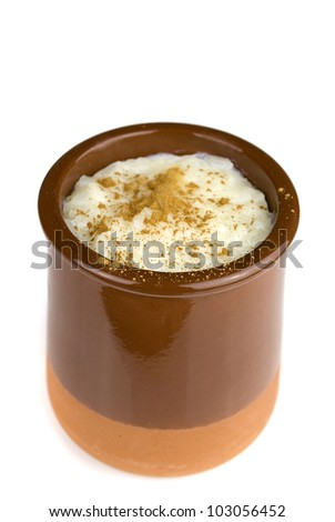 homemade rice with milk and cinnamon in a ceramic bowl isolated on white