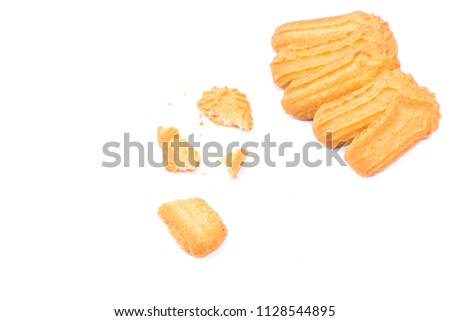 Homemade round ginger biscuit with jam, peanuts and raisins. Delicious honey sweetmeal digestive cookie isolated on a white background with light shadow. Cooking concept. Detailed closeup studio shot #1128544895