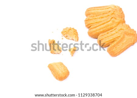 Homemade round ginger biscuit with jam, peanuts and raisins. Delicious honey sweetmeal digestive cookie isolated on a white background with light shadow. Cooking concept. Detailed closeup studio shot #1129338704