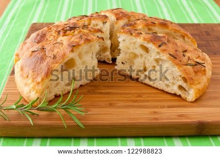 Homemade round Italian rosemary Focaccia bread sliced.