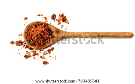 Shutterstock Homemade Salt with Dried and Crushed Sweet Red Paprika in Wooden Spoon isolated on White background