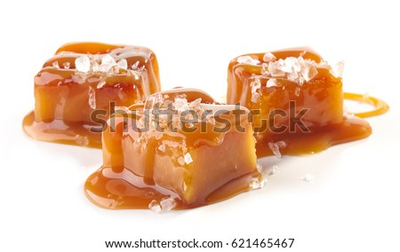 homemade salted caramel pieces isolated on white background