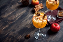 Homemade sangria (apple cider, punch, fruit wine) for autumn and winter holidays - festive Christmas, Thanksgiving  drinks.