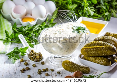 Shutterstock Homemade sauce tartar tartara with ingredients eggs olive oil lemon, capers, parsley, pickles on white background