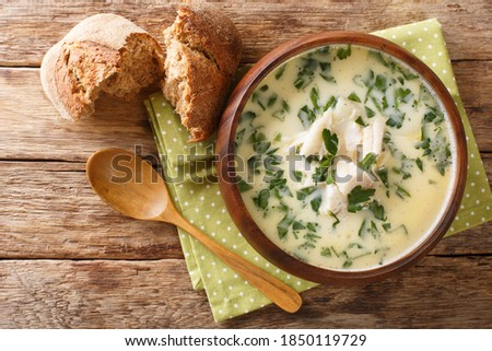 Homemade scotch milk soup cullen skink with smoked haddock and potatoes close-up in a bowl on the table. Horizontal top view from above ストックフォト ©